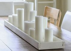 Make a simple wooden candle tray. The perfect tabletop item to carry you through Thanksgiving, Christmas and beyond! Lined with simple white candles, it makes every meal more festive. - looong one Candle Centerpieces For Home, Dining Room Table Centerpieces, Decoration Table, Diy Candle Tray, Everyday Table Centerpieces, Long Candle Holder, Candle Vases, Centrepieces, Dining Table