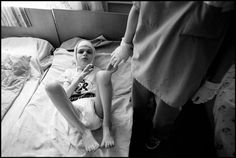 Novinli Asylumn, Minsk.A volunteer from Wales , working there for the summer with many of her class mates, comforts a child ahe has been caring for in a ward.  Paul Fusco/Magnum Photos
