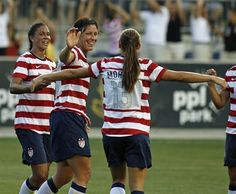 Shannon Boxx (left) and Abby Wambach (center) congratulate Alex Morgan after one of her two goals against China on May 27, 2012. The United States won 4-1. (H. Rumph Jr./Associated Press)