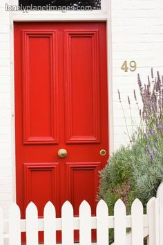 There is something I like about a house with a red door.