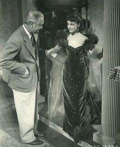 Victor Fleming has a talk with Vivien Leigh during filming of Ashley Wilkes' birthday party scene in GONE WITH THE WIND