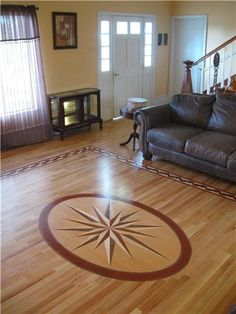 Red Oak wood floor with Medallion & Border from Heartland Inlays.