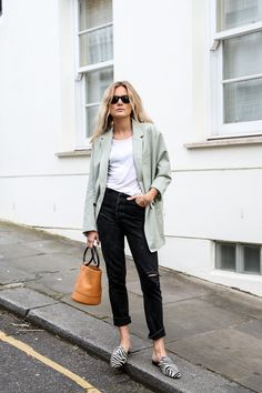 Zebra print shoes are easy to pull off when you wear them with the right matching clothes like this tailored jacket.