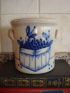 This salt glazed pottery crock is grey and cobalt blue with blueberries in a basket design. It measures 5.5 tall and is in very fine