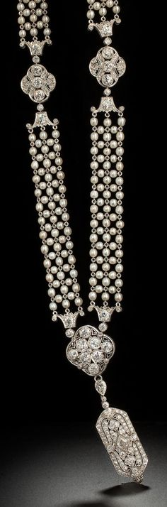 A Belle Epoque diamond pendant watch,Tiffany & Co., C.H. Meylan, with a cultured seed pearl and diamond necklace, circa 1910. The seed pearl necklace with diamond pierced and openwork terminals, suspending a rectangular pendant watch, the reverse pavé-set with diamonds, dial signed Tiffany & Co., movement signed C.H. Meylan, Swiss, mounted in platinum.