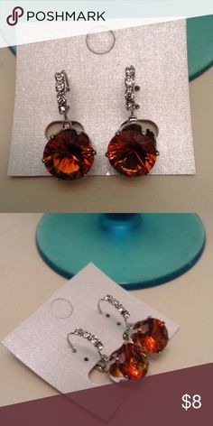 Beautiful Amber Crystal euro back earrings NWT Brand new never used large he Amber Crystal stone prong with clear prong set rhinestones. The stones are not glued they are set with prongs. Definitely eye catches. Gorgeous Jewelry Earrings