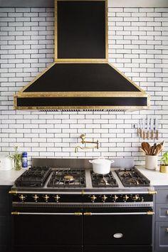 Domino Magazine - kitchens - black range hood, black kitchen hood, black and gold range hood, black and gold kitchen hood, black and brass r...