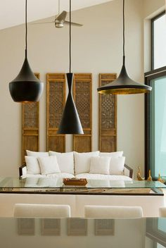 asian-style screen panels as wall art ; black and gold hanging lamps