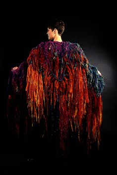 Robert Hillestad || CELEBRATION CAPE #36: TRIBAL DANCE IN RAFFIA AND WOOL 1997 || Wool yarn and raffia Hand-knitting with fringe technique, yarn manipulation