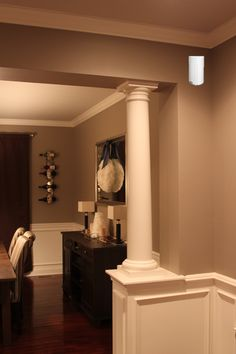 I like this half wall with column design for between for Pictures of columns in living room
