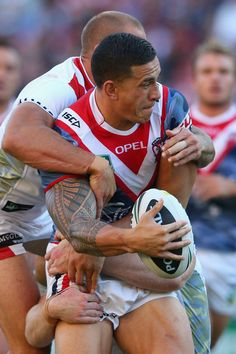 Roosters v Dragons: Sonny Bill Williams of the Roosters is tackled during the round seven NRL match between the Sydney Roosters and the St George Illawarra Dragons at Allianz Stadium on April 25, 2013 in Sydney, Australia.