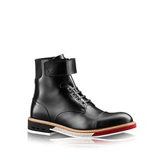 Discover Louis Vuitton Sword Ankle Boot: This casual-chic ankle boot in glazed calf leather is given a fashion-forward edge by its distinctive rectangular eyelets and technical three-tone outsole. The elastic insert at the back makes it easy to slip on and off.