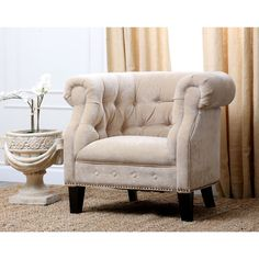 Bring sophistication and class to your living room with this Cabo Fabric Nailhead Trim Armchair. This furniture piece is constructed of wood and top quality designed fabric.