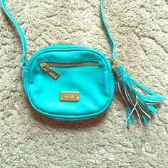 Nine West cross body purse This purse is super cute but the only problem is the ink stain on the inside. Still basically new though! Nine West Bags Crossbody Bags