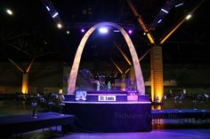 St. Louis themed centerpieces: A giant arch with a plexi building skyline lit from below by Exclusive Events, Inc.