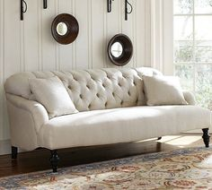 Curved tufted sofa