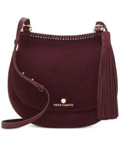 Vince Camuto Aiko Saddle Crossbody $278.00 Braided trim and a swishy tassel elevate the on-trend look of Vince Camuto's fine leather saddle bag, topped with a custom-fit crossbody strap for portability.
