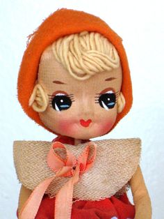 Bradley Doll from Japan. Hand Painted. The Yarn Hair is the earlier version. And smaller. I love the insane color of the eyes and no two are alike.