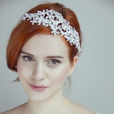 stunning headpiece for the bride. If you want the best officiant for your Outer Banks, NC, ceremony, contact Rev. Barbara Mulford: myobxofficiant.com/