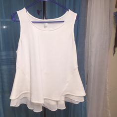Cute shirtsleeve blouse Worn once. Really cute, polyester,  size 2X plus size, the bottom it's really cute it's has like this see threw fabric goes around the back. Cute for a girls night out! Forever 21 Tops Blouses