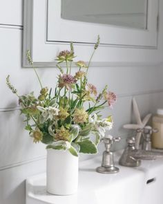 "Nosegay  ""It's like a posy you'd gather from the garden for the pleasure of it, without thinking too hard,"" Ngo says of this herbal collection of lamb's ear, astrantia, and lavender in a ceramic drinking cup."