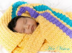 Lah Lah's baby blanket, made to order, shell stitch, 44.5 inches by 35.5 inches made in sunshine yellow, bright blue, and brillant purple