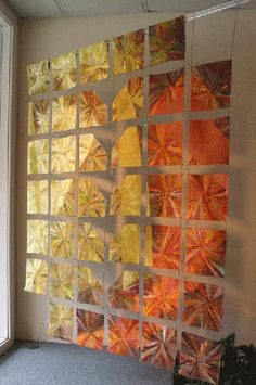 """""""Sorok"""" by Melisse Laing.  """"Sorok"""" was inspired by a cast glass piece by artist William Carlson. The name is Russian for forty - which is how many individual """"blocks"""" are in the quilt."""