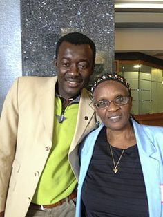 """Raymond Ngarboui, a refugee from Chad, and Marceline Ndayumvire from Welcome Place who welcomed him.  When she greeted him at the airport she said, """"You are no longer refugees.  You are in a city that welcomes you home."""""""