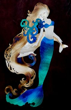 Mermaid with shy Dolphin.  7-13-14  I just ordered something similar to this with sea turtles included along with the dolphin from Laura Knight the famous Metal Art Artist that I'll be picking up in Sept. 2014 at the Ventura Aloha Beach Festival.   http://www.seecalifornia.com/festivals/ventura-aloha-beach-festival.html