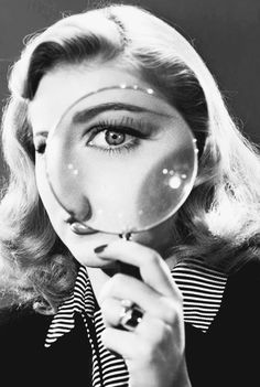 Ginger Rogers eye spying through magnifying glass.