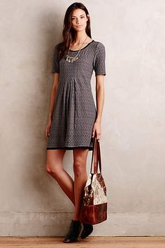 I like the dress bc it's simple and can be worn with tights, a cardigan and riding boots.