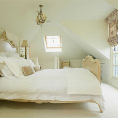 Country glamour defines this white bedroom. You need little more than a quaint chandelier and an ornate bed to re-create the look. Source