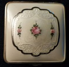 VINTAGE MAKEUP COMPACT IVORY GUILLOCHE PINK ROSES EMBOSSED WHITE BACKGROUND