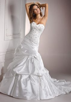 Gown features beading, lace and corset bodice.