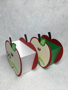 Looking for a fun favor box? These apple treat cups are perfect for a birthday party, welcome back to school/school function, book club meeting or???  The boxes measure approximately 4 x 4 (including the top the stem). The inside box is tapered and measures approximately 1 7/8 x 3 1/2. This box will easily hold a small juice box or a generous portion of candies etc.  You receive a set of 6 boxes