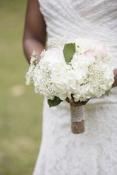Lathcha & Jamel on Borrowed & Blue.  Photo Credit: The Click Chick Photography. Bridal bouquet with baby's breath, blush roses, white hydrangeas, burlap, lace. Charleston, SC Wedding Photography