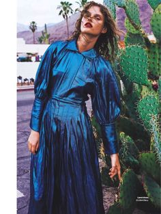 Posing next to cactus, Giedre Dukauskaite models blue lamé dress from Ellery