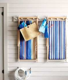 Beach Sling Chairs. When not in use hang them on the wall. They're quite decorative! Featured on BBL: http://beachblissliving.com/sling-chairs/