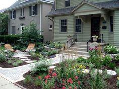 Cottage Garden front yard instead of lawn. Grasses, perennials, walkways, sitting area. Homedit - interior design and architecture inspiration