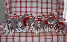 Sock monkeys on a red and white plaid couch...  I'm in heaven!