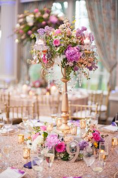 floral tree centerpiece with hanging lights - photo by Off BEET Productions http://ruffledblog.com/bright-purple-and-pink-wedding-in-new-jersey