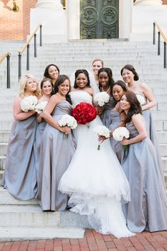 Bride and her beautiful bridesmaids! Love the brides bouquet of beautiful bold red flowers!! Veronica & Doyin's Annapolis Loews Hotel wedding by Charlotte Jarrett Events
