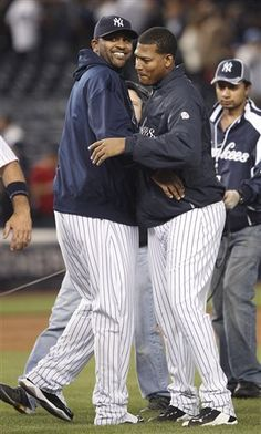 GAME 55: Wednesday, June 6, 2012 - New York Yankees' CC Sabathia, left, celebrates with Ivan Nova after the Yankees defeated the Tampa Bay Rays 4-1 in a baseball game at Yankee Stadium in New York. (AP Photo/Seth Wenig)