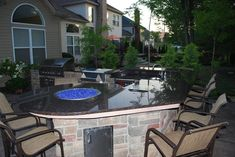 Raised bar includes 5 foot table with built fire pit by Outdoor Dreamscapes.