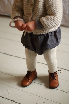 Ribbed stockings, bubble skirt, little knitted cardigan - so sweet!