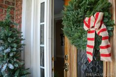 striped burlap bow  Wreath on front door