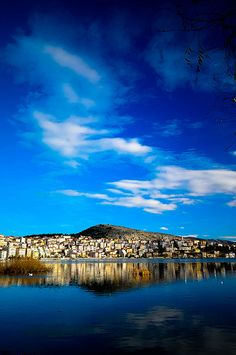Macedonia Kastoria The town is known for its many Byzantine churches, Ottoman-era domestic architecture, fur clothing industry and trout. Beautiful World, Beautiful Places, Greece Mythology, Places To Travel, Places To Visit, Macedonia Greece, Paradise On Earth, World Cities, Beautiful Architecture