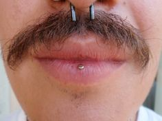 This is called an ashley piercing, it's like a vertical labret but done through the inside of the lower lip.