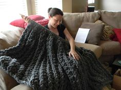 """From fan LuckyHanks: """"This is my new Giant Super Chunky Knit Blanket!! Holding 4 strands of worsted weight yarn together I chained using a Q hook. Then I took that super chunky chain and started to knit with it This pic is the blanket about 8 skeins in. I am half way there!!"""""""