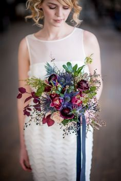 Love the waxflower and thistle, the dark purple elements are lovely too